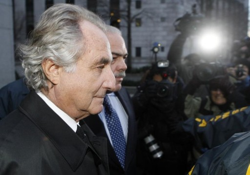 FILE - Bernard Madoff is escorted from Federal Court in New York January 5, 2009. REUTERS/Lucas Jackson