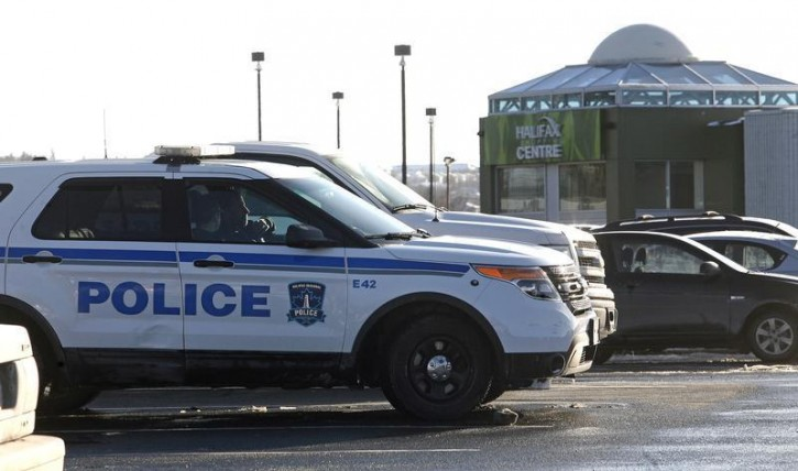 Police cars are seen outside the Halifax Shopping Centre, which was named by police as the intended target of an attack which they said was thwarted in Halifax, Nova Scotia February 14, 2015.  Reuters