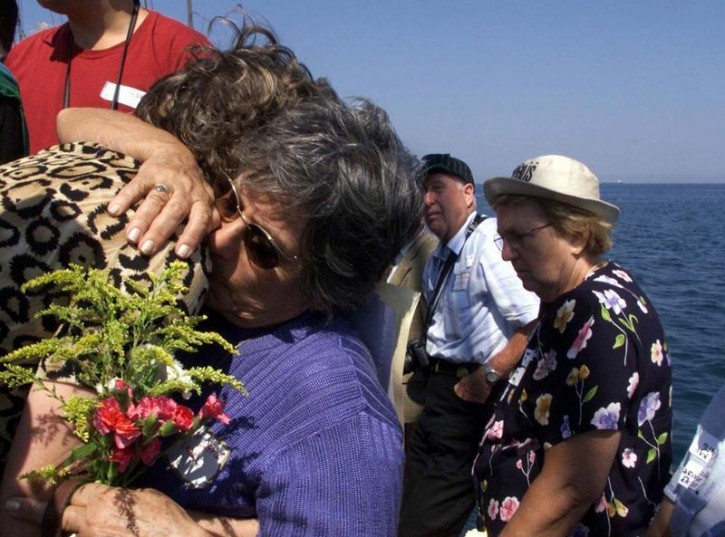 FILE - Relatives of the Struma victims comfort each others during a memorial service off the coast of Istanbul, Turkey, on Sunday September 3, 2000. The vessel carrying Jewish refugees who fled the Holocaust was torpedoed and sunk in 1942 in Black Sea, killing 769 people. Reuters