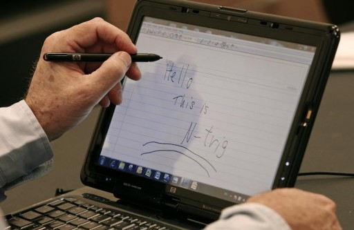 FILE - Amihai Ben-David, chief executive of N-trig, demonstrates a pen and touch device at his office in Kfar Saba, near Tel Aviv April 6, 2009. REUTERS