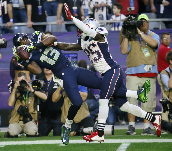 Seattle Seahawks wide receiver Chris Matthews (13) catches a pass in front of New England Patriots cornerback Kyle Arrington (25) during the first half of NFL Super Bowl XLIX football game Sunday, Feb. 1, 2015, in Glendale, Ariz. (AP Photo/Matt York)