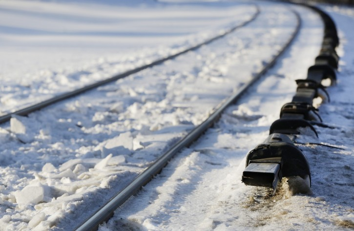 The electrified third rail, right, runs next to Metro-North Railroad tracks, Friday, Feb. 6, 2015, in Valhalla, N.Y. An SUV driver and five train passengers were killed Tuesday evening in a rush-hour collision in Valhalla. (AP Photo/Mark Lennihan)