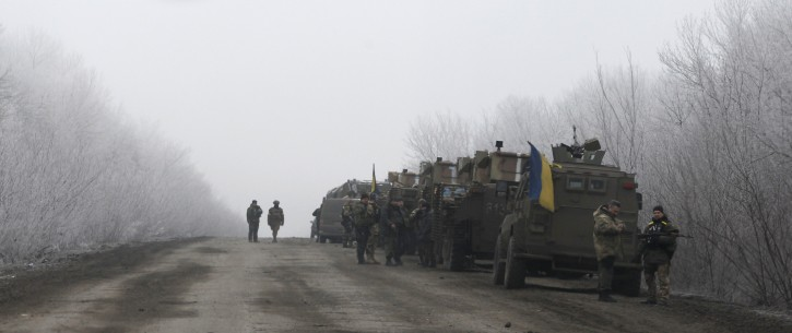 Ukrainian military convoy stop on the road between the towns of Dabeltseve and Artemivsk, Ukraine, Saturday, Feb. 14, 2015.  AP