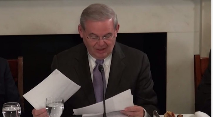 In Washington DC on Feb. 11, 2015 with members of Agudath Israel of America's national board of trustees, Senator Bob Menendez reviews a printout of the tweets which were determined to be non-threatening in nature several days ago by the county prosecutor's office.