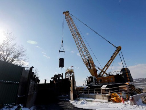 In this Friday, Jan. 9, 2015 photo, a crane lifts a bucket of rocks from Shaft 6B in Wappinger, N.Y. Crews starting a project to fix a section of the Delaware Aqueduct that provides New York City with about half its drinking water are busy blasting and drilling hundreds of feet below ground. (Mike Groll, AP / AP)