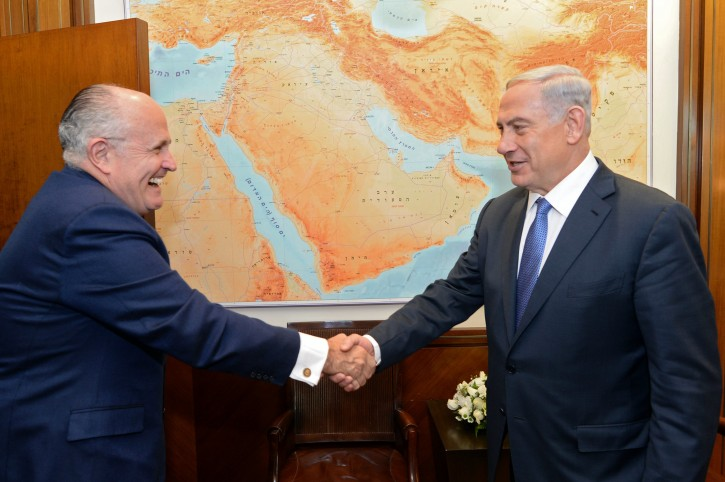 A handout image released by the Israeli Government Press Office (GPO) of Israeli Prime Minister Benjamin Netanyahu (R) shaking hands with New York City mayor Rudolph Giuliani (L) as they meet in Jerusalem, Israel, 01 February 2015.  EPA/KOBI GIDEON