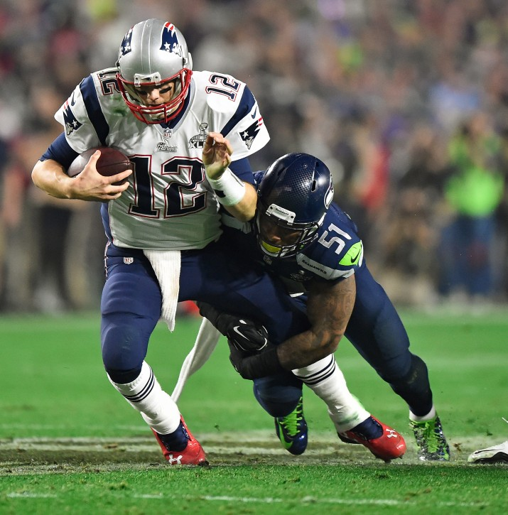 New England Patriots quarterback Tom Brady (L) is sacked by Seattle Seahawks outside linebacker Bruce Irvin (R) during the second half of Super Bowl XLIX between the New England Patriots and the Seattle Seahawks at the University of Phoenix Stadium in Glendale, Arizona, USA, 01 February 2015. EPA/LARRY W. SMITH