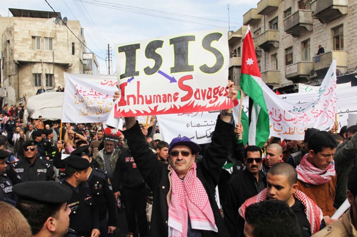 A Jordanian holds a placard against the group calling themselves Islamic State (IS) during a march in memory of executed pilot Muath al-Kassasbeh after noon pray in downtown Amman, Jordan, 06 February 2015. EPA