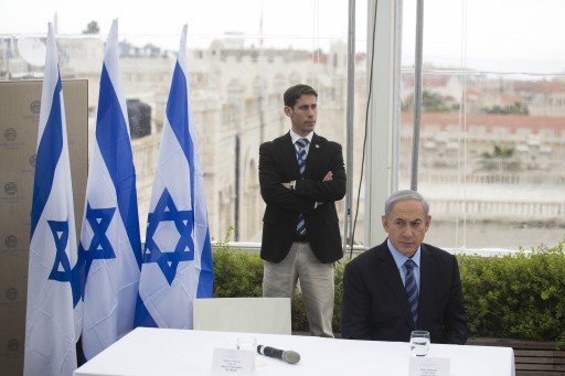 Israeli Prime Minister Benjamin Netanyahu (R) looks on during a press conference at a Hotel's rooftop restaurant overlooking the Old City of Jerusalem, Israel, 23 Februaty 2015. EPA/ABIR SULTAN