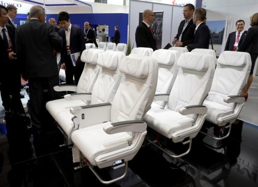 """FILE - Rows of airline seats are displayed at a booth during the """"Aircraft Interiors Expo"""" in Hamburg April 8, 2014. REUTERS"""