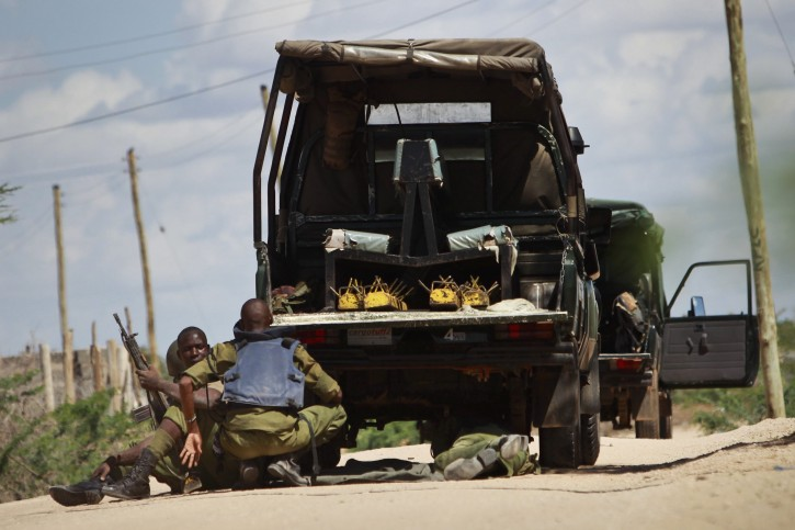 Kenyan soldiers take cover as shots are fired in front of Garissa University in Garissa town, located near the border with Somalia, some 370km northeast of the capital Nairobi, Kenya, 02 April 2015.  EPA