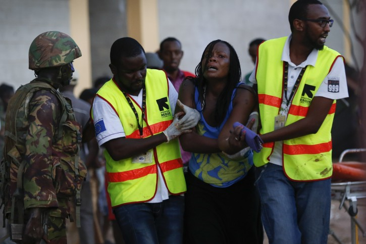 A woman reacts as she is rescued out of the building where she had been held hostage as Kenyan soldiers entered the university  building after a fierce fights with attackers at  Garissa University in Garissa town, located near the border with Somalia, some 370km northeast of the capital Nairobi, Kenya, 02 April 2015.