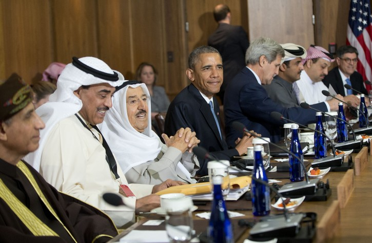 President Barack Obama sits with Kuwaiti Emir Sheikh Sabah Al-Ahmad Al-Sabah, Secretary of State John Kerry, center right, and Gulf Cooperation Council leaders and delegations at Camp David, Md., Thursday, May 14, 2015.(AP Photo/Pablo Martinez Monsivais)