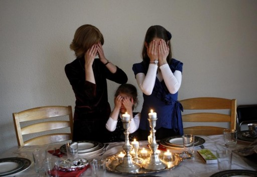 FILE - A Jewish Family lights Shabbos candles in their home in Budapest November 30, 2012.REUTERS