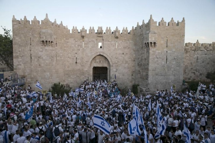 Israelis hold flags as they take part in a march marking Jerusalem Day near Damascus Gate outside Jerusalem's Old City May 17, 2015.  Reuters