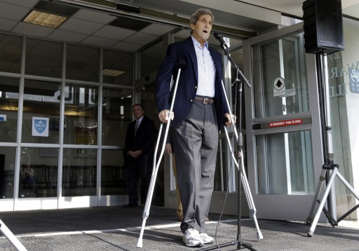 Secretary of State John Kerry speaks to media as he is discharged from Massachusetts General Hospital Friday, June 12, 2015, in Boston. Kerry was released from the hospital after undergoing surgery on a broken leg sustained in a May 31 bicycle accident in France. (AP Photo/Elise Amendola)