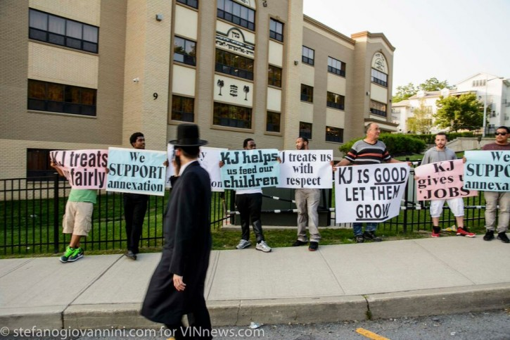 Protesters hold signs outside a public hearing on the proposed KJ annexation in Kiryas Joel, NY.