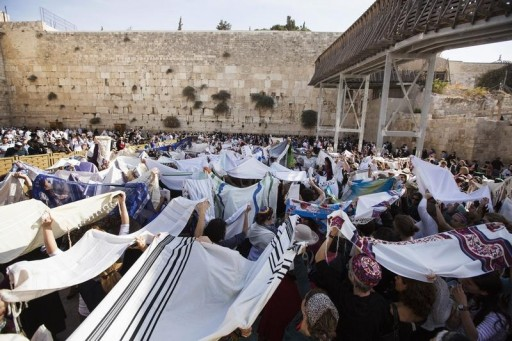 "FILE - Members of ""Women of the Wall"" group hold prayer shawls during a monthly prayer session at the Western Wall in Jerusalem's Old City November 4, 2013.REUTERS"