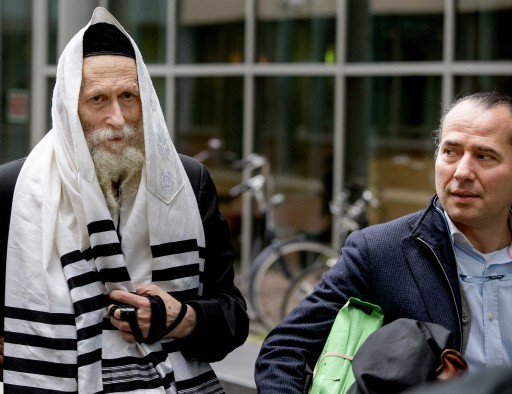 FILE - The controversial Israeli Rabbi Eliezer Berland (C), who is suspected of sexual abuse in his own country, arrives with his lawyer Louis de Leon (R), at the court in Haarlem, The Netherlands, 17 November 2014. EPA