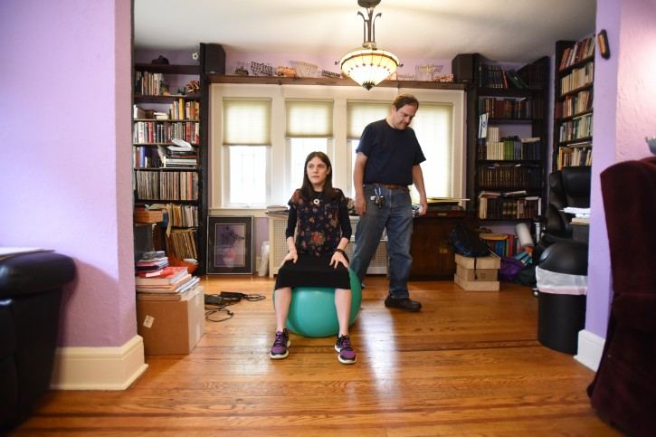 Rivka 23 shows and talks about how she exercises with a ball that helps her with muscle development and function. Her father Arthur is behind her.    --  CHRIS PEDOTA / THE RECORD