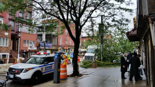File photo of police on Lee Avenue near Bondo's 24 Supermarket in Williamsburg, Brooklyn, NY.<br /> (© 2015. All rights reserved)