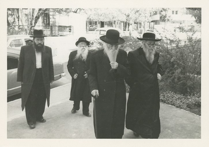 In this auction is included a photograph of the rabbis of the delegation arriving at one of the meetings, Rabbi Isser Zalman Meltzer, and Rabbi Meir Karelitz, [brother of the Chazon Ish],  Rabbi Tzvi Pesach Frank, Rabbi Menachem Porush. (Kedem Auction house)
