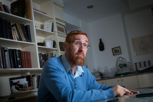 FILE - Portrait of Yehuda Glick in his home in jerusalem. Glick is an American-born Israeli rabbi and civil rights activist who campaigns for expanding Jewish access to the Temple Mount. March 12, 2015. Photo by Miriam Alster/FLASH90