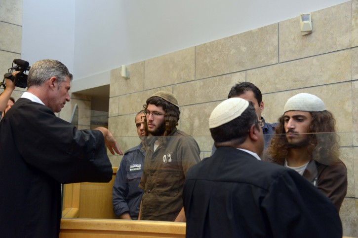 Yinon Reubeni and Yehuda Assaraf, two of the suspects of vandalizing the church of the Multiplication of the Loaves and Fishes in Tabgha, on the shore of the Sea of Galilee last month speaks to their lawyers at the Nazareth Magistrate's Court on July 29, 2015. Photo by Basel Awidat/Flash90