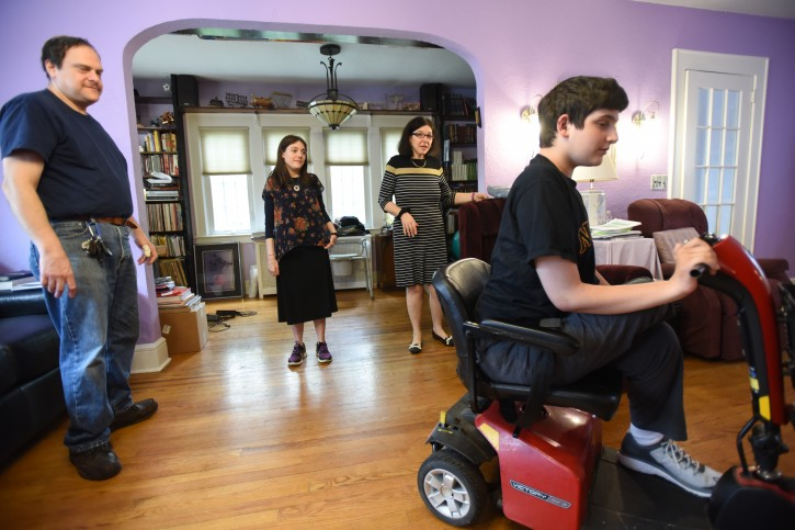 Arthur the father watches  Tzvi 18 drive away as his sister Rivka 23 and mother Esther watch as well on June 21, 2015..  the parents (Arthur and Esther) have four children who all have CMT, a muscle degenerative disease (similar to muscular dystrophy but not quite). There is no cause or cure and is genetic. --  (VINnews.com Courtsey of CHRIS PEDOTA / THE RECORD)