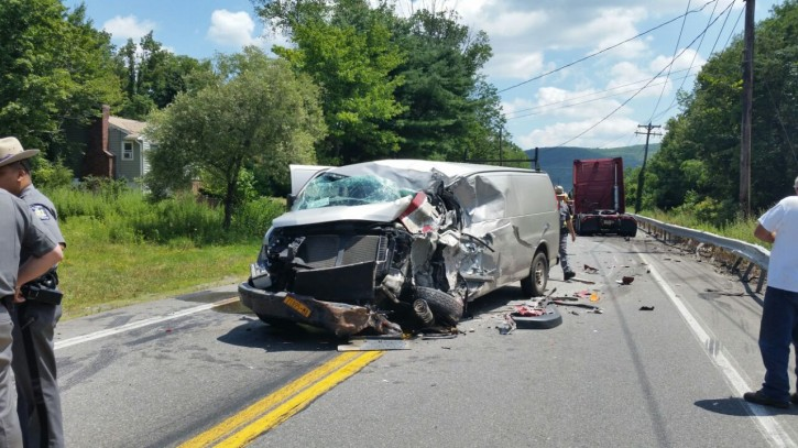 A tractor trailer and car collided at Nininger Road and Dunderberg Road in Monroe on July, 20 2015. (VINNews.com)
