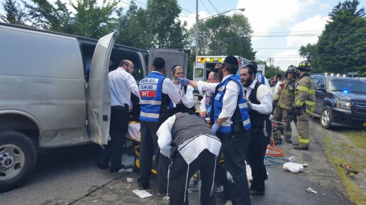 Hatzalah removing a Kiryas Joel resident who was injured in the accident between a tractor trailer and the van he was driving at Nininger Road and Dunderberg Road in Monroe on July, 20 2015. (VINNews.com)