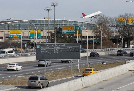 FILE - Cars on the Grand Central Parkway pass LaGuardia Airport in New York, Wednesday, Jan. 21, 2015.   (AP Photo/Kathy Willens)