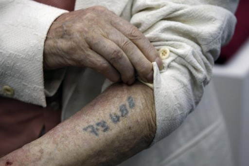 FILE - Polish-born Holocaust survivor Meyer Hack shows his prisoner number tattooed on his arm during a news conference at the Yad Vashem Holocaust Museum in Jerusalem June 15, 2009. REUTERS