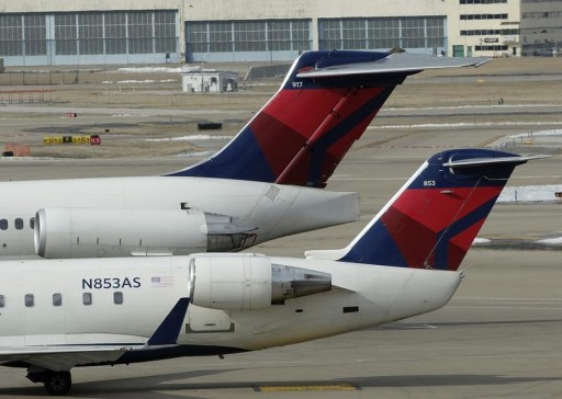 FILE - Two delta Airlines jets sit at their gates at the Lambert - St. Louis International Airport, in St. Louis, Missouri, March 4, 2013.  REUTERS/Tom Gannam