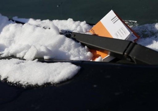 FILE - A parking ticket issued by the NYPD is seen on a car in the Queens borough of New York January 7, 2015.REUTERS
