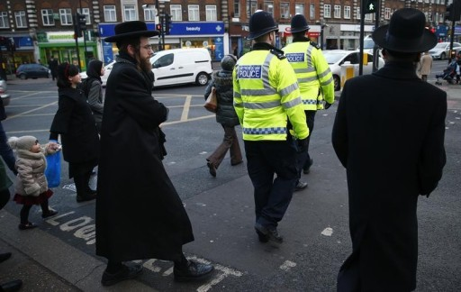 FILE - Members of the Jewish community cross the road in north London January 20, 2015. REUTERS