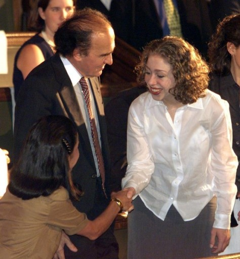 File - Chelsea Clinton (R) is greeted by lawyer and human rights activist Samuel Pisar (C) and his wife Judith (L) before Formner U.S. First Lady Hillary Rodham Clinton delivered a speech at La Sorbonne in Paris June 17, 1999. Reuters