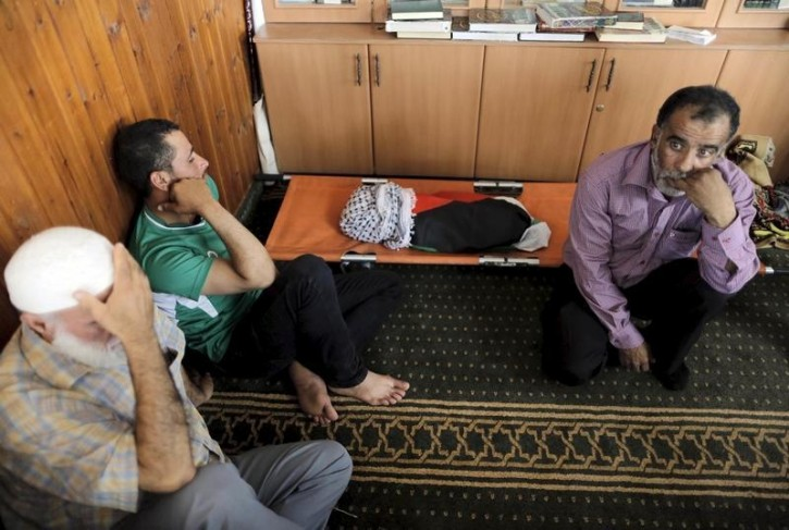 Mourners react next to the body of 18-month-old Palestinian baby Ali Dawabsheh, who was killed after his family's house was set to fire in a suspected attack by Jewish extremists in Duma village near the West Bank city of Nablus July 31, 2015. Reuters