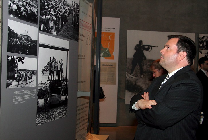 A handout photograph supplied by the Yad Vashem Holocaust Memorial on 21 May 2009 shows the visiting canadian Minister of Citizenship and Immigration, Jason Kenney, as he views photographs displayed in the Yad vashem Holocaust memorial in Jerusalem.  EPA/YAD VASHEM