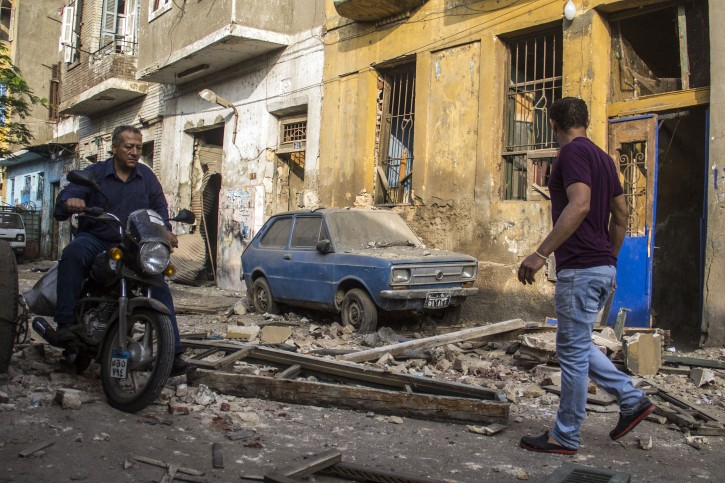 Egyptians in the street outside their damaged houses near the site of a bomb blast at the Italian Consulate in Cairo, Egypt, 11 July 2015.  EPA