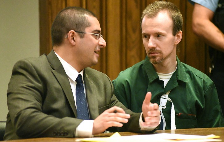 David Sweat, right, talks with his lawyer, Joseph Mucia before his court hearing Thursday Aug. 20, 2015 at Clinton County Court in Plattsburgh, N.Y. Sweat, a convicted killer who escaped June 6 from the Clinton Correctional Facility and spent more than three weeks on the run was arraigned Thursday on criminal charges stemming from the breakout. Sweat pleaded not guilty to first-degree escape and promoting prison contraband. He is due back in court on September 29. (Rob Fountain/Press-Republican via AP)