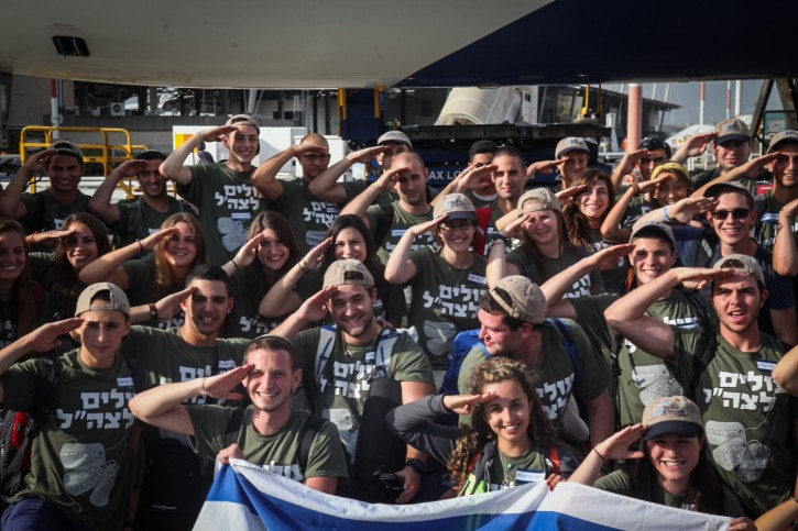 About 59 young Jews seen upon their landing at Tel Aviv Ben Gurion Airport, as they immigrate to Israel to enlist in the IDF, on August 18, 2015. The lone soldiers to-be are among over 200 new immigrants to Israel that landed today. Photo by Flash90 *