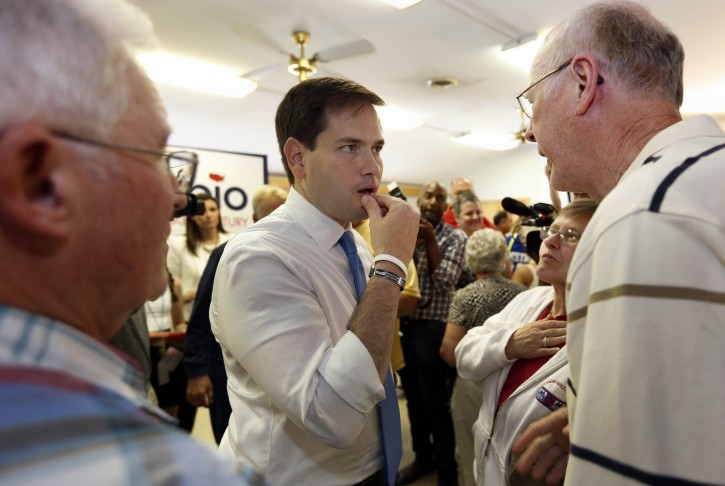 Republican presidential candidate, Sen. Marco Rubio, R-Fla., talks with voters during a campaign stop at the VFW, Wednesday, Aug. 26, 2015, in Littleton, N.H. (AP Photo/Jim Cole)