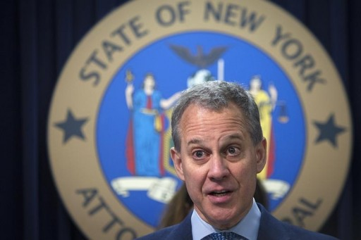 FILE - New York State Attorney General Eric Schneiderman speaks during a news conference in the Manhattan borough of New York August 21, 2014. REUTERS