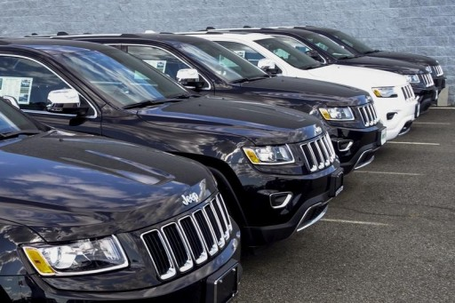 FILE - 2015 Jeep Grand Cherokee are exhibited on a car dealership in New Jersey, July 24, 2015. REUTERS