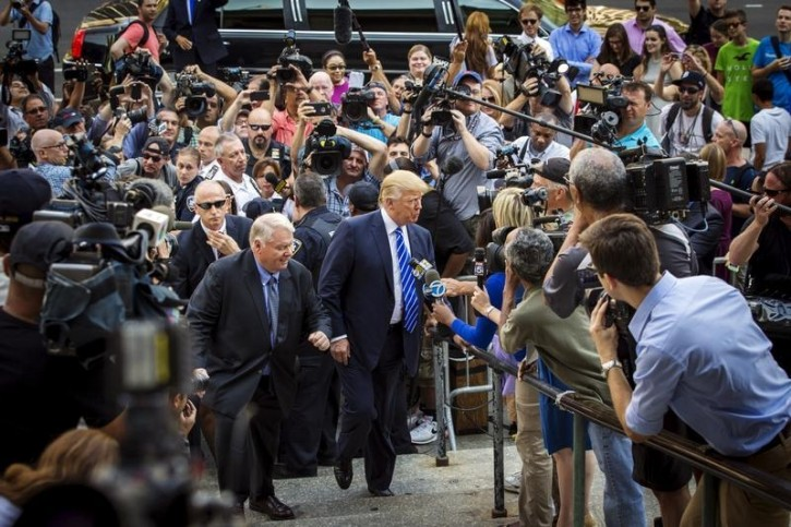 U.S. Republican presidential candidate Donald Trump (C) arrives for jury duty at Manhattan Supreme Court in New York August 17, 2015. The real estate mogul's service came after a state judge in March fined him $250 for failing to respond to summonses to serve jury duty five times since 2006.    REUTERS/Lucas Jackson
