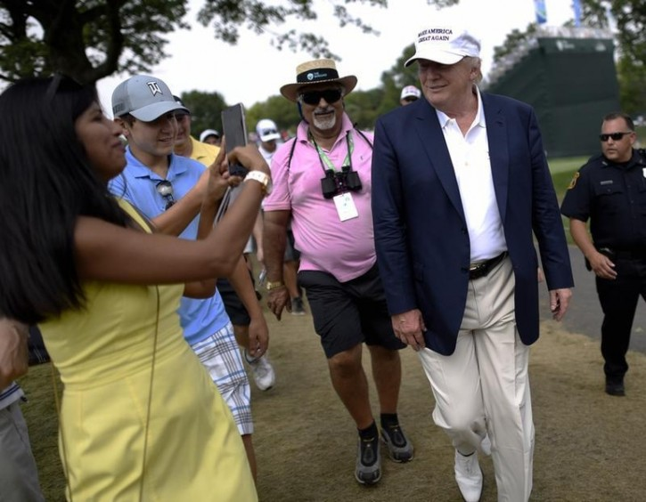 Presidential candidate and businessman Donald Trump greets golf fans near the 2nd tee during the final round of The Barclays at Plainfield Country Club. REUTERS