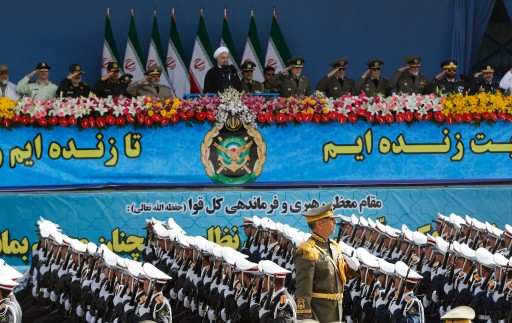 File: Iranian President Hassan Rowhani (C, top) watches soldiers of the Iranian armed forces marching by during a military in Tehran, Iran. EPA/ABEDIN TAHERKENAREH