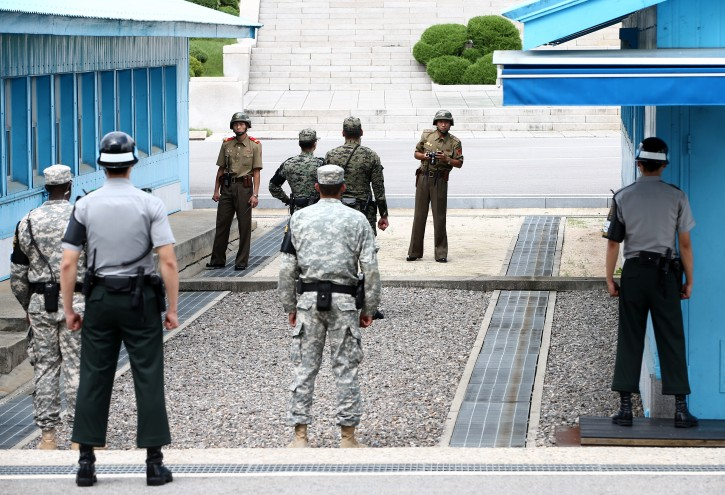 FILE - North Korean soldiers (background) look towards South Korea as South Korean soldiers stand guard at the Military Demarcation Line in the Demilitarized Zone (DMZ) in the border village Panmunjom, South Korea, 27 July 2015.  EPA