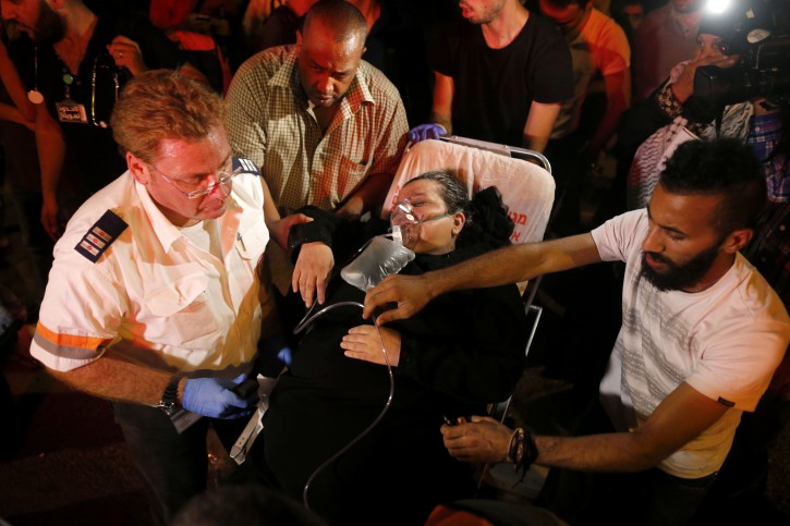 Israeli magen david evacuating wounded Palestinians protestor during a protest for the release of Palestinian prisoner Mohammed Allaan outside the Israeli Barzilai medical center in Ashkelon, Israel, 16 August 2015. EPA/ABIR SULTAN